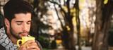 Composite image of man smelling mug of coffee  - 176193876