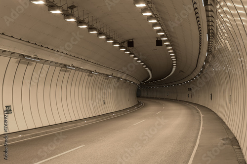 Bend in a road tunnel without traffic Plakát