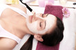 Face Treatment. Woman in Beauty Salon Gets Marine Mask
