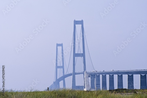 Cars driving up the ramp to the first giant tower of the Great Belt Bridge in De Poster
