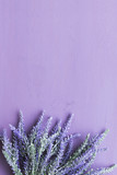 Lavender flower on purple wooden background. - 176211820