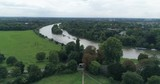 Aerial approaching view of a bend on the river Thames in Richmond, West London - 176213693