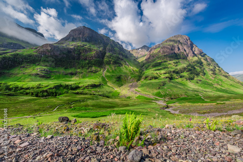 Breathtaking view of the mountains in Glencoe at sunrise, Scotland Poster