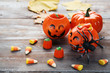 Halloween candies on brown wooden table