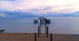 Aerial approaching view of the destroyed West Pier in Brighton at sunset - 176234249