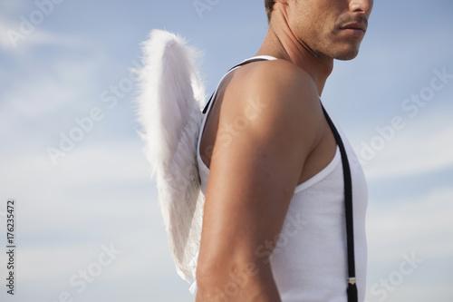 man wearing angel's wings Poster