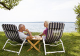 senior man and woman in deck chairs - 176236022