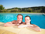 couple in pool - 176236643