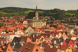 Red tile roofs cityscape. Church of Saint Vitus- UNESCO World Heritage Site. Summer sunny day. Cesky Krumlov (Krumau), Czech Republic. - 176238821