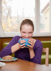 girl drinking from large cup