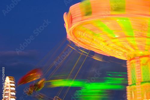 Fotobehang Amusementspark Rotating carrousel by night