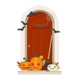 Halloween Door Decorations. Front door with Halloween decorations and pumpkins - 176244664