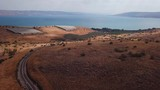 Sea of Galilee (Kineret) - Aerial footage above the surrounding mountains towards the Kineret. - 176245886
