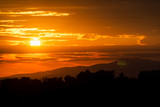 Beautiful sunset sky. Sky Background. The setting sun in a cloudy sky background