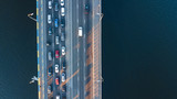 Aerial top view of bridge road automobile traffic jam of many cars from above, city transportation concept  - 176253874