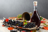 Black chokeberry and bottle with juice . - 176255440