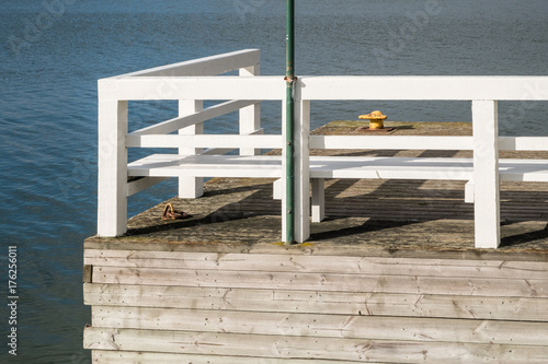 Detail of a wooden pier on a summer day