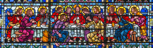 LONDON, GREAT BRITAIN - SEPTEMBER 16, 2017: The stained glass of Last Supper the Pantokrator in church St Etheldreda by Joseph Edward Nuttgens (1952).
