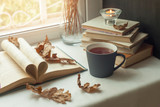 autumn still life. books, leaves, cup and dry tiny flowers in vase red candlestick on window. Concept of autumn reading time and romantic, Warm, cozy seat  opened book, rustic style home decor - 176259852
