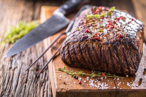 Fotobehang Steakhouse Beef steak. Juicy Rib Eye steak in pan on wooden board with herb and pepper
