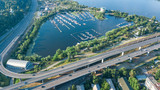 Aerial top view of Darnitsky bridge, Dnieper river and cityscape from above, city of Kiev, Ukraine