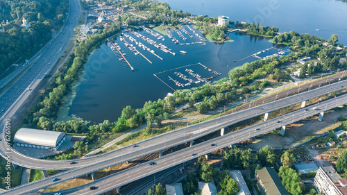 Poster Aerial top view of Darnitsky bridge, Dnieper river and cityscape from above, city of Kiev, Ukraine