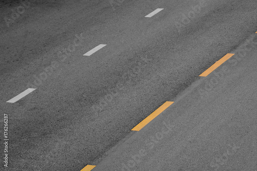 Yellow and white paint line on black asphalt Poster