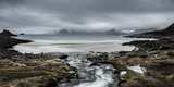 A river flows into the wild sea on the coast of the Lofoten Islands - 176274685