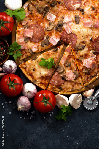 pizza with sausage and cheese and ingredients, vertical, top view