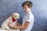 Teen boy with golden retriever