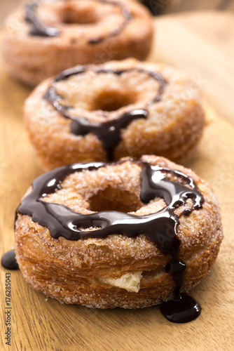 donuts chocolate on wood Poster