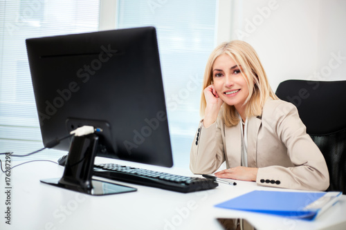Mature businesswoman working in her office
