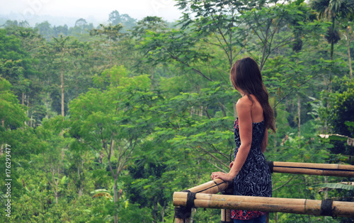 Fotobehang Bali Ubud, Bali - 30th September 2017: Young woman looking at beautiful scenery of a coffee plantation near Ubud