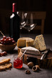 Cheese board, wine and fruits