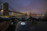 handlebars of a motorcycle in the foreground in front of New York City - 176299690