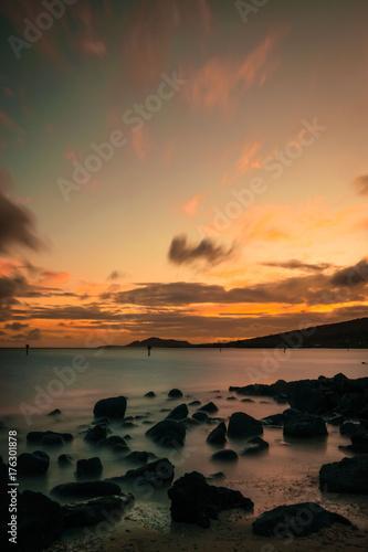 Foto op Canvas Zee zonsondergang Bay