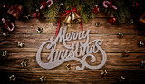 Merry Christmas lettering with decoration on wood