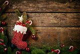 Festive Christmas border with red boot or stocking