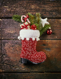 Christmas red boot against wooden background