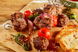 Meatball kebabs with toasted baguette - 176308431