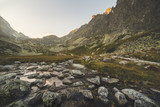 Creek in the Valley under the Mountain Peaks at Sunset. Velicka Valley, High Tatra, Slovakia. - 176309879