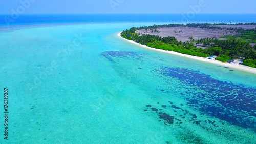 Fotobehang Groene koraal P01132 Aerial flying drone view of Maldives white sandy beach on sunny tropical paradise island with aqua blue sky sea water ocean 4k