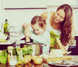 Happy family cooking  soup - 176326413