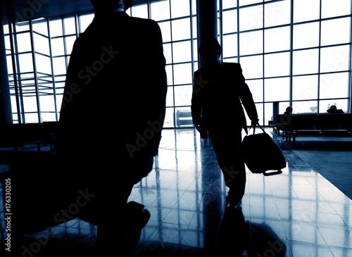 Fridge magnet Business travelers at airport.