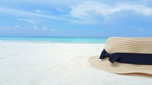 P01697 Maldives white sandy beach hat on sunny tropical paradise island with aqua blue sky sea ocean 4k