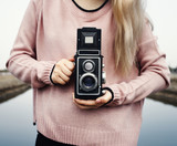 Girl using a vintage camera outdoors - 176333892