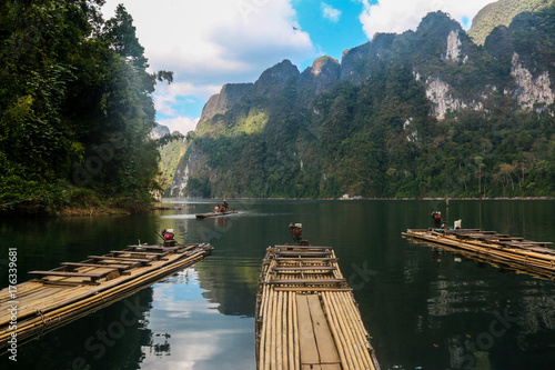 Fotobehang Guilin Beautiful landscape,natural attractions with mountains ,lake, tourist on raft boat,blue sky background in Ratchaprapha Dam at Khao Sok National Park,Suratthani ,THAILAND.