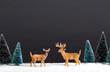 Christmas holiday theme with reindeer and Christmas trees