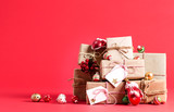 Collection of Christmas present boxes on a red background - 176340015