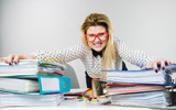 Energized business woman in office - 176340254
